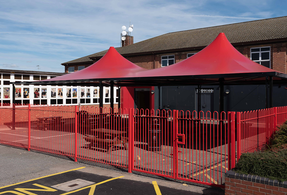 Red fabric canopy at Haven High Academy - ORION Conic